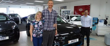 Mrs Joanne Stephens takes delivery of the first all electric New Kia e-Niro in Jersey
